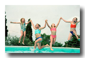 Four girls jumping into a pool